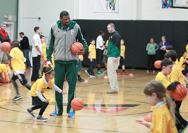 Boston Celtic Assistant Coach Walter McCarty works with kids at a special  nutrition and fitness community  event designed to show 150 area youth and adult participants how they can incorporate healthy eating and physical fitness into their daily routine.