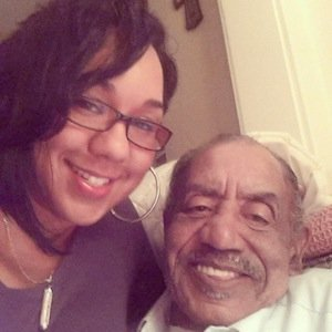Medric Mills Jr. and his granddaughter (Courtesy of Facebook)
