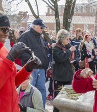 Beryle Downs and her granddaughter Rian Cully blow bubbles every 33 seconds to symbolize how frequent heart attacks occur in America. The Heart Health Foundation 'painted the town red' with a Heart Walk parade to promote Heart Health Month on Saturday, February 1, 2014 in Annapolis. According to the Centers for Disease Control and Precvention (CDC), about 600,000 people die of heart disease in the United States every year—that's one in every four dealths.