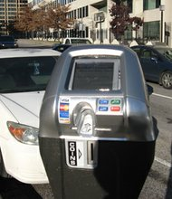 The Parking Authority of Baltimore City has been installing parking meters over the last nine years that meet the Americans with Disabilities Act guidelines. (Above) This vehicle in Baltimore displays a disability placard. According to statistics, nearly 2,000 placards are stolen from vehicles in Baltimore City every year.