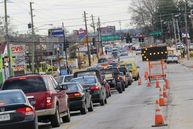 Motorists navigate the obstacle course that Candler Road has become as Kemi Construction crews work on a $7.1 million water main project.