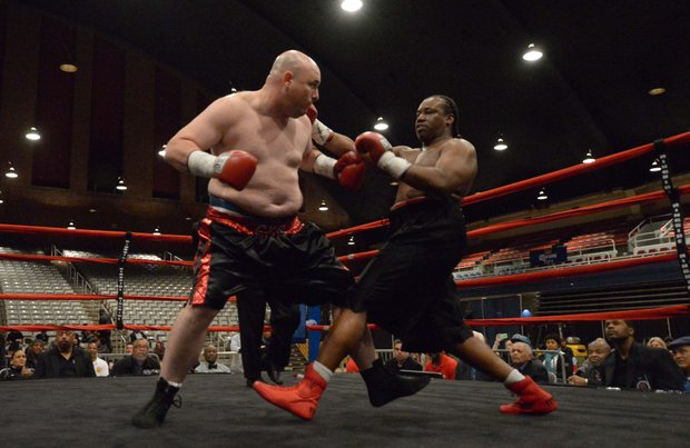 Nick Cyr (left) faces Alando Pugh in a match at the D.C. Armory on Friday, Feb. 7. Pugh won by knockout.