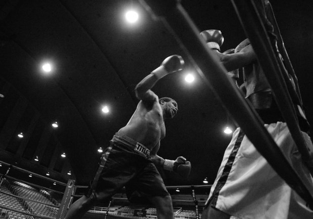 "Willis ""The Prophet"" Lockett readies a punch against Julius Fogle during a six-round bout at the D.C. Armory on Friday, Feb. 7. Lockett won by unanimous decision."