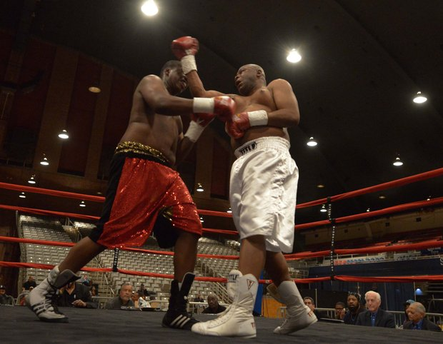 Franklin Edmondson (right) throws an uppercut against Zakki Scott on Friday, Feb. 7 during a bout at the D.C. Armory. Scott won by unanimous decision.