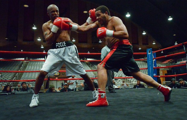 "Willis ""The Prophet"" Lockett (black trunks) faces Julius Fogle in a six-round bout at the D.C. Armory on Friday, Feb. 7. Lockett won by unanimous decision."