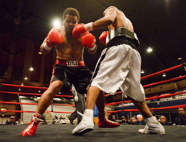"Julius Fogle lands a short left hook against Willis ""The Prophet"" Lockett during a six-round bout at the D.C. Armory on Friday, Feb. 7. Lockett won by unanimous decision."