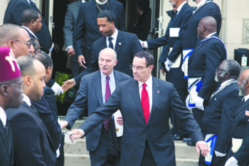 D.C. Mayor Vincent Gray and Council Chairman Phil Mendelson leave Canaan Baptist Church in Northwest on Feb. 8 after attending the funeral service of longtime D.C. resident Medric Cecil Mills Jr. Mills collapsed near a fire station in the District but was denied assistance.