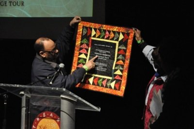 John Best, president of Capitol Entertainment Services, presents an African American Heritage Tour quilt to Washington Informer publisher Denise Rolark Barnes on Saturday, Feb. 7 in Southeast.