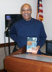Simeon Wright seen here with a picture of his book tittled Simeon's Story: An Eyewitness Acount of the Kinapping of Emmett Till.