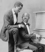 Eubie Blake at the piano and Noble Sissle behind him.