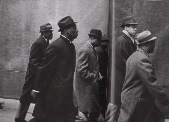 Bilal marching with Malcolm X