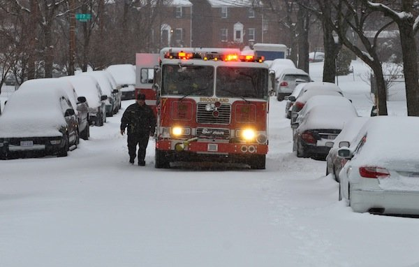 A D.C. fire engine attempts navigates a snow-filled street in Northeast en route to a call on Feb. 13, after a winter storm dumped nearly a foot of snow on much of the region.