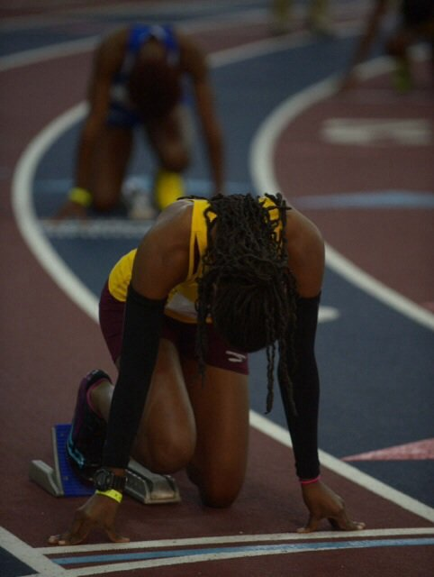 A runner waits in the starting blocks during the MEAC Indoor Track and Field Championships at the Prince George's Sports & Learning Complex in Landover, Md., on Friday, Feb. 14.