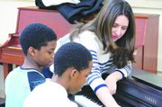 Classical pianist Simone Dinnerstein introduces 5th-graders at W.B. Patterson Elementary School in Southeast to the works of German composer Johann Sebastian Bach. She also provided a hands-on demonstration and students had the opportunity to team with the pianist and compose a musical medley.