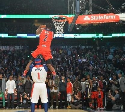 Washington Wizards guard John Wall clinched the NBA's slam dunk championship with a reverse dunk over the team mascot. (Courtesy of the Wizards' Twitter account)