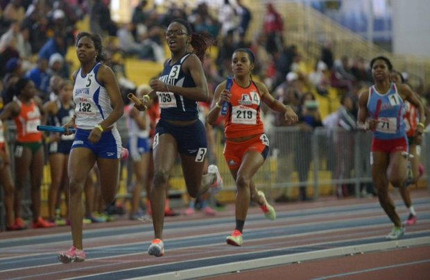 Michelle Cole (second from left) of Howard University runs the first leg of the 4x400m relay during the MEAC Indoor Track and Field Championships at the Prince George's Sports & Learning Complex in Landover, Md., on Saturday, Feb. 15.