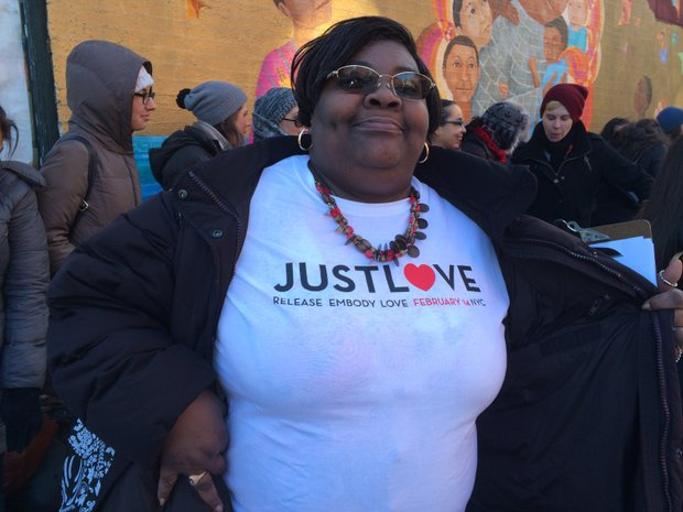 Rusti Miller-Hill shows off her shirt in honor of the Valentine's Day flash mob in East Harlem.