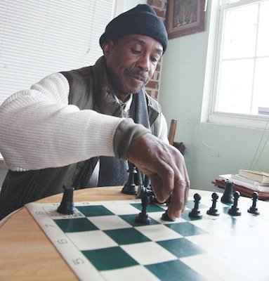 "Eugene Brown hosted an open house on Saturday, Feb. 15 at ""The Big Chair Chess Club,"" for those interested in learning the ""Game of Kings."""