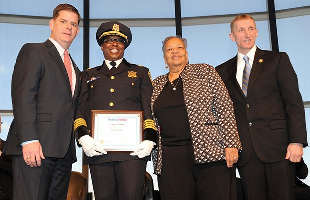Mayor Martin J. Walsh and Commissioner William Evans swear in Superintendent Lisa Holmes during the Boston Police Department Command Staff appointment ceremony at the JFK Library in Dorchester.