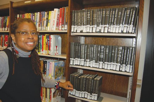 North Portland Library Branch Manager Patricia H. Welch presents selections from the library's unique Black Resource Collection. The compilation consists of over 7,000 materials, including various books, periodicals, films and music relating to the African-American and overall black experience.