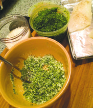 Topping white fish filet with pesto panko