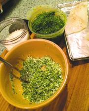 Topping white fish filet with pesto panko