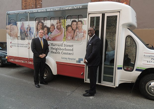 Harvard Street Neighborhood Health Center (HSNHC) unveiled its new shuttle bus that will help increase access to medical services. Patients that require care unavailable at the center will be transported to Carney Hospital in Dorchester.  Shown are Charley Murphy, president and CEO of HSNHC (l) and Andy Davis, President and CEO of Carney Hospital.
