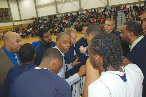 At the center of his basketball squad, Portland Community College Coach Tony Broadous makes an impassioned appeal to his guys to get themselves a victory. Wins have become a trend at the once underperforming program since Broadous' came to the PCC program after years of coaching at Grant High School. PCC went on to win the Feb. 19 game against Chemeketa Community College and secured a spot in the playoffs for the first time ever in school history.