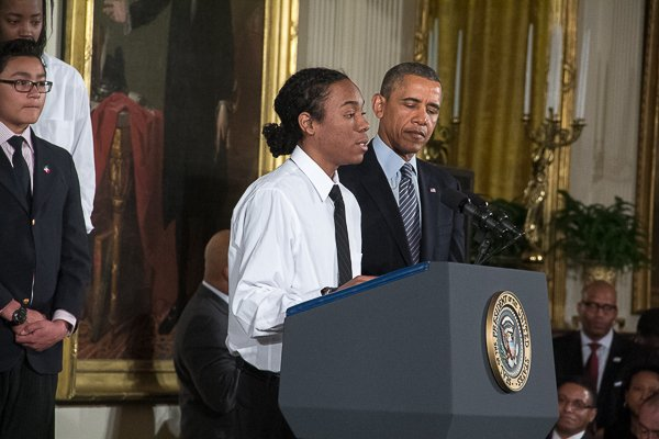 """Christian Champagne, 18, a senior at Hyde Park Career Academy in Chicago, introduces President Obama during the launch of Obama's """"My Brother's Keeper"""" initiative in the East Room of the White House on Thursday, Feb. 27."""