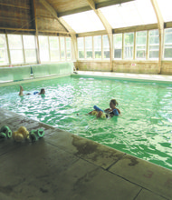 Swimming or taking a class in the heated indoor pool feels more like being in a greenhouse as there are walls of windows on three sides.