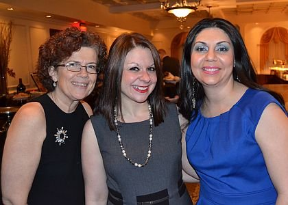 Lawnside Education Foundation, Inc. Treasurer Jane Fronczak, right, was joined by awardees Jennifer Cilurso, center, and Joeliza Rosado-Lowers of Susquehanna Bank at the foundation's fourth annual dinner dance and auction on Feb. 22 at The Merion in Cinnaminson.