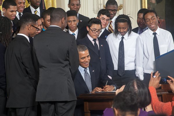 """President Obama signs the Presidential Memorandum on his """"My Brother's Keeper"""" initiative at the White House on Feb. 27."""