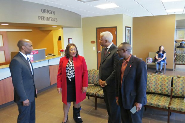 Commissioner Sharon Barnes Sutton, U.S. Rep. Hank Johnson and Commissioner Larry Johnson talk with Oakhurst Medical CEO Jeff Taylor.