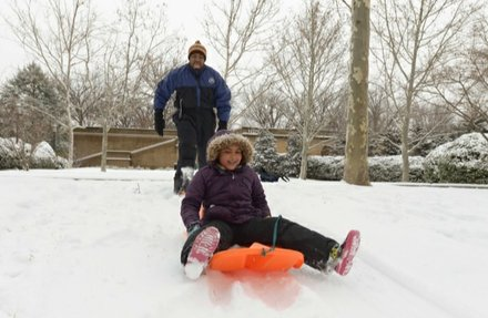 Vance Levy enjoys a snowy day with his daughter Jahmila, 8, at Meridian Hill Park in Northwest on Monday, March 3.
