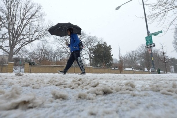 A man walks along 16th Street in Northwest D.C. on Monday, March 3, after the region was hit by a massive snowstorm.