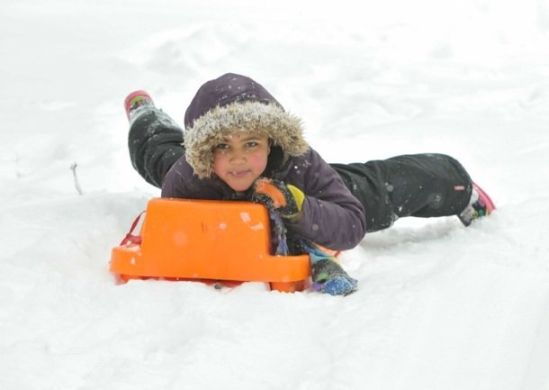 Jahmila AlBanna-Levy, 8, rides a sleigh down a hill at Meridian Hill Park in Northwest D.C. on Monday, March 3, after a massive snowstorm hit the region.