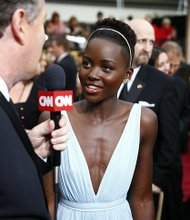 Lupita Nyong'o on the red carpet before the 2014 Academy Awards.