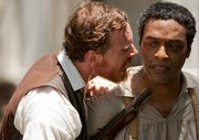 "Steve McQueen's ""12 Years a Slave,"" starring Chiwetel Ejiofor (r) and Michael Fassbender (l), became the first film directed by a black man to win the Best Picture Oscar."