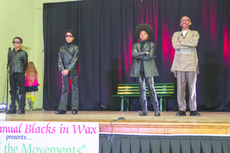 The Southeast Tennis & Learning Center held its 8th annual Blacks in Wax program on Feb. 28 at the Community Showcase auditorium in the Eagle Center at McGogney in Southeast. Students portray (from left) Stokely Carmichael (David Patterson), Huey P. Newton (Elijah Ragland), Angela Davis (Ameera Malik) and Ron Maulana Karenga (Marjé Lyons).