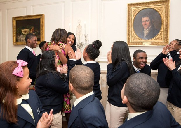 First Lady Michelle Obama greets students from Orchard Gardens in Roxbury after the students performed at a luncheon for National Governors Association spouses in the Map Room of the White House last week.