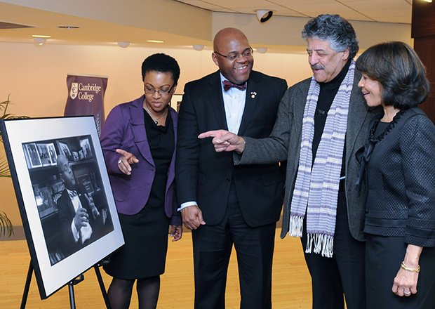 """Former U.S. Senator William """"Mo"""" Cowan (2nd l) is presented with a portrait from photographer Don West (2nd r) as part of Cambridge College's ongoing Leadership Speaker Series. The portrait is part of West's  Portraits of Purpose exhibit which pays tribute to individuals known and unknown for their significant contributions to the communities in which they live. Joining them are Stacy Cowan (l) and Cambridge College President Deborah C. Jackson."""