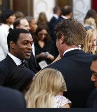 Chiwetel Ejiofor on the red carpet before the 2014 Academy Awards.