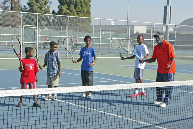Richard Williams instructs young tennis players at the Rancho Cienega Sports Complex./OW photo by Jason Lewis.