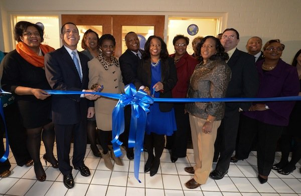 Maryland Lt. Gov. Anthony Brown (D), Prince George's County Executive Rushern Baker III (D), Prince George's County health officer Pamela Creekmur, Global Vision Community Health Center founder Toyin Opesanmi and others prepare to cut the ribbon at the Global Vision Community Health Center in Capitol Heights, Md., on Thursday, March 6.