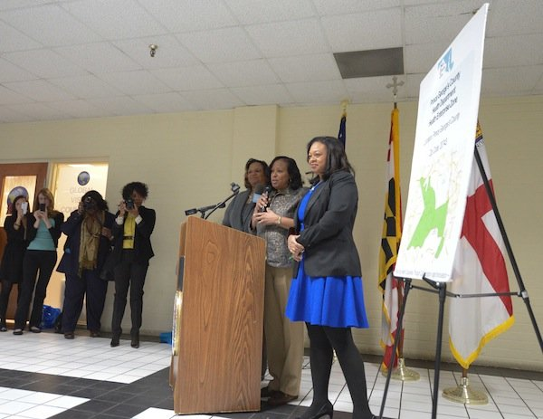 From left: Prince George's County Council members Ingrid Turner (D-District 4), Andrea C. Harrison (D-District 5) and Karen Toles (D-District 7) speak about Global Vision Community Health Center founder Toyin Opesanmi during the grand opening of the health center in Capitol Heights, Md., on Thursday, March 6.