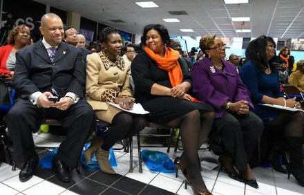 Global Vision Community Health Center founder Toyin Opesanmi (center) shows emotion as Prince George's Council Member Andrea C. Harrison (D-District 5) gives remarks about her during the grand opening of the health center in Capitol Heights, Md., on Thursday, March 6.