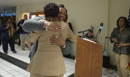 Prince George's County Council Member Ingrid Turner (D-District 4), hugs Global Vision Community Health Center founder Toyin Opesanmi during the grand opening of the health center in Capitol Heights, Md., on Thursday, March 6.