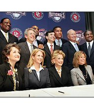The group of minority owners of the Washington Nationals Baseball Team. Faye Fields is seated fifth from the left. Fields prides herself for helping others to thrive in an often- unforgiving corporate world. She seeks to provide African Americans with opportunities in corporate America and she enjoys watching the success of those she has provided a helping hand.