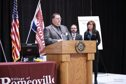 Brunswick Zone in Romeoville received the Small Business Award from Mayor John Noak at Thursday's State of the Village Address. Tom Sorfleet, general manager of Brunswick Zone, accepted the award and gave a short speech.