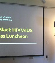 HIV/STD Prevention and Care Program Manager Jennifer Schneider welcomes attendees to the Third Annual Black HIV/AIDS Awareness Luncheon.